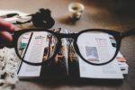 glasses and magazines by Ewan Robertson on Unsplash.com