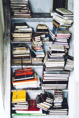 books in a closet by Simon Petrol on Unsplash