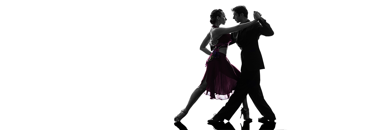 Silhouette of man and woman dancing the tango